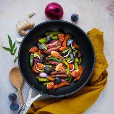 Wok de canard, poivrons et figues